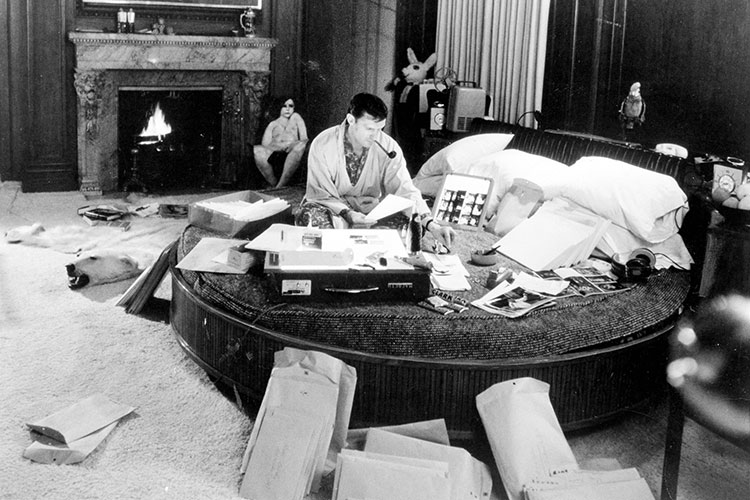 Hefner working in his bedroomoffice at the Chicago mansionc | Photo provided by Playboy Enterprises)