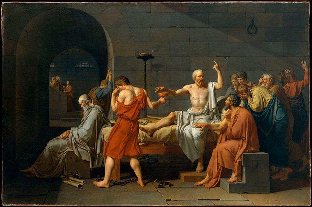 El conocido cuadro (1787) de Jacques Louis David sobre la muerte de Sócrates rodeado de sus discípulos...menos Platón que estaba enfermo | Fuente: wikipedia.com